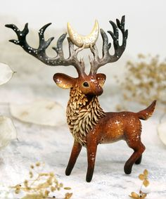 Christmas polymer clay deer sculptures by Evgeny Hontor. Christmas Fantasy animals for Home Decor - Decorate your room with fantastic polymerclay animals and create an amazing collection of polymer clay figurines for homedecor   #claydiy #fantasyanimals