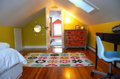 Love how colorful this is... and the fact that it's an attic room (for some reason have always thought they were cool ha)