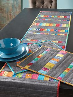 Color Streaks Runner and Place Mats Pattern Patchwork Use Your Favorite Scraps for a Beautiful Table Set - Quilting Digest Patchwork Table Runner, Table Runner And Placemats, Table Runner Pattern, Quilted Table Runners, Modern Table Runners, Quilted Table Toppers, Contemporary Table Runners, Quilt Placemats, Color Streaks
