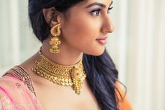 A stunning Gold choker set and Jhumkas by AZVA for a Pink Lehenga by Jade by Monica & Karishma at WeddingSutra on Location.