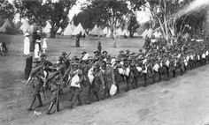 11th Battalion troops march out of Blackboy Hill Camp on their way to the port of Fremantle in preparation for their embarkation, 31st October, 1914.