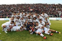 Players of Cagliari celebrate during the Serie B winner award ceremony during the Daniele Conti Testimonial Match at Stadio Sant'Elia on May 23, 2016 in Cagliari, Italy.