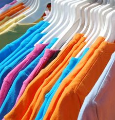 Tips for displaying items at garage sale: make makeshift display tables with a large board and 2 tv trays.  Make clothing racks with 2 ladders and a pole.
