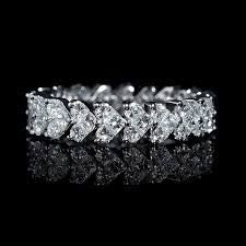 Image result for wedding diamond heart bands