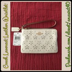 "COACH LASERCUT LEATHER WRISTLET Coach Laser Cut Flowers with Coach Horse & Carriage Gold Tone Metal Logo  Top Zip Closure - Gold Tone Hardware  Interior Features Fabric Lining & 2 Slip Pockets  Approximate Measurements: 6"" (L) x 4"" (H)  Color: White Glitter Coach Bags Clutches & Wristlets"