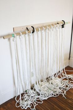 Curtains of woven rope in a simple knot macrame technique . On a stick ( eaves ) is fixed ropes (number and length is determ...