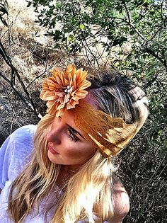 """Beautiful wide stretchy lace headband paired with a silk flower accented with 3 pearl buttons. Slip on style for an effortless beautiful look. Lace headband with silk flower that measures 4"""" diameter."""