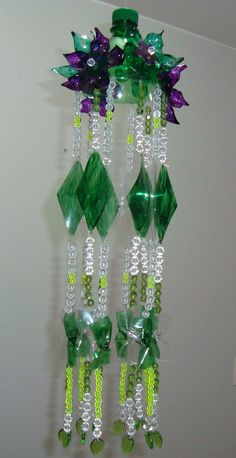 20 DIY Ideas for Recycling Plastic Bottles would be a great bead curtain, if you had enough of them . . . .