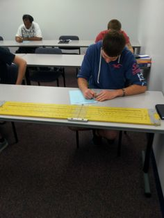 Gave a two-part final exam today. With/without calculator. This dude says Ill take the non-calculator and whips out this 4 foot slide rule. Year = made. - Imgur