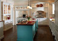 Coastal Cottage Kitchen Design. Turquoise island with butcher block top. All other cabinets white with white/black/grey (dalmation style) mixed counters.