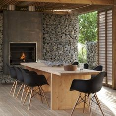 Black Eames chair & natural wood