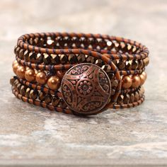 Love this kind of thing! Rust Leather Cuff Bracelet Bohemian Style by AbacusBeadCreations