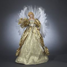 $69.99-$84.99 Deluxe Seasons of Elegance Gold Lighted Fiber Optic Angel Christmas Tree Topper - From the Seasons of Elegance Collection Item #J5904  Deluxe angel tree topper wears an elegant gold gown with silver accents and holds flowers in her hand Constant color changing fiber optic wings include: gold, blue, red, green, purple and clear Her porcelain face and hands give her the look of a tra ...
