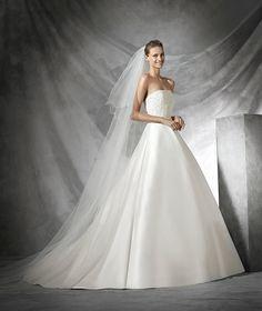 Torsa, vestido de novia con pedrería y escote palabra de honor