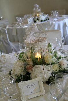 Our candle lit Birdcages surrounded by a voluptuous garland Stocks, Roses, Peonies, Hydrangeas and Sweet peas with strings of pearls and lace