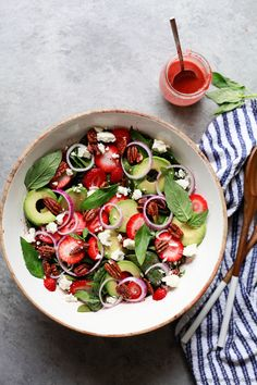 Baby spinach salad with strawberries, pecans, avocado and a soft cheese like feta or a vegan alternative. Don't miss this easy strawberry balsamic vinaigrette dressing. This gorgeous summer strawberry spinach salad is always a crowd-pleaser.