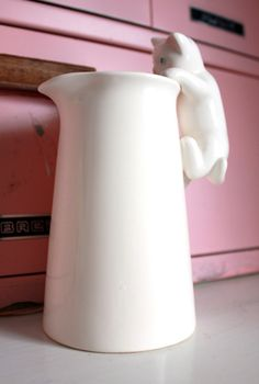 Vintage Sweet Kitten Peering Into the Milk Jug White Ceramic Vase.  via Etsy.
