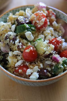 Healthy Greek Quinoa Salad, Gluten-free   pinch of salt & pepper, quinoa, red or white wine, cucumber, grape tomatos, olives, red pepper, lemon, garlic,and parmaion cheese