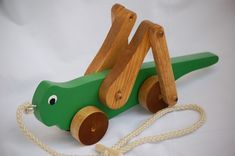 Grasshopper Pull Toy by McCoyToys on Etsy, $18.50