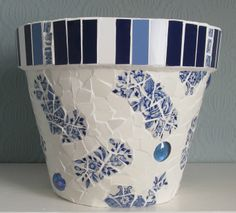 All parts of the plate recycled in this terracotta pot!