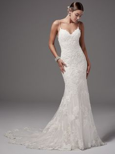 Sottero and Midgley - BRISTOL, Chic and alluring, this fit-and-flare wedding dress features shimmering lace appliqués and bead detailing over tulle and Inessa jersey. Gorgeous crisscross strap details accent the gown's open back, completing the shoulder strap V-neckline. Finished with zipper closure.