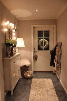 Home Design and Decor , Home Small Front Hall Design Ideas : Small Front Hall Design With White Console Table With Drwers And String Lights And Floor Lamp And Coat Hooks Ikea Hemnes Cabinet, White Shoe Rack, Contemporary Hallway, Hallway Inspiration, Hallway Ideas, Entryway Ideas, Corridor Ideas, Entryway Organization, Entrance Ideas