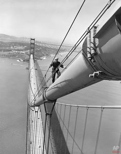 Bill Gaure,  a maintenance worker on the Golden Gate Bridge in San Francisco, nears the top of the north tower after nearly a half-mile uphill hike from the center of the span, May 15, 1952.