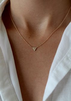 """14k gold 16"""" Chain (6) 1mm white diamond Dimensions: 5.75mm The triangle that points downward is one of the oldest symbols of the divine power of the female. It can symbolize Love, Truth, and Wisdom"""