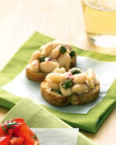 Capers and minced red onion liven up cannellini beans in this easy appetizer. If you like, add garlic or fresh herbs to the mixture as well.