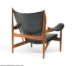 """Finn Juhl // Niels Vodder // """"Chieftain Chair"""". A teak easy chair. Seat, armrests and back upholstered with black leather, back fitted with buttons. Designed 1949. This example made early 1960s by cabinetmaker Niels Vodder, stamped by maker."""