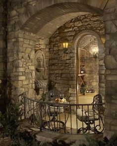 Wine room patio with stone wall fountain. #WineCellar