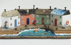 You know the saying 'if walls could talk'? These look like they're huddled together deep in conversation! Paper Doll House, Paper Houses, Kirsty Elson, Ceramic Houses, Wooden Houses, Reclaimed Wood Art, Driftwood Art, Driftwood Ideas, Putz Houses