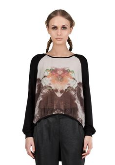 https://www.cityblis.com/4509/item/6410 | Dark entropy top - $140 by Freak Factory |  Luxurious, loose cut top with a unique print. To create a lighter piece suitable for cooler autumn days and evenings, Freak Factory has combined a silk-cotton mix front with black sleeve and back details in a lightweight knitwear. The asymmetric front-back hemline, with a black knitwear finish deta... | #Tops/Blouses
