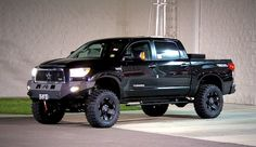 Black, lifted, Toyota Tundra....one day you will be mine : ) minus the fact it is lifted I love this one :)