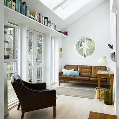 that leather sofa, that built-in book shelf. via lovenordic design blog.