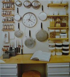 Install a pegboard wall organizer. You can hang pots and pans directly from this or install open shelves over top of it. Infinite storage and display options!