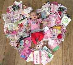 Cute idea to keep all the cards you got when she was born, and then use them for a 1st bday photo opp!