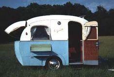A tiny hatchback vintage camper!
