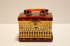 Vintage lucite purse with brass cut-out - Dorset Fifth ave $60 from @VintageFunkery on Etsy