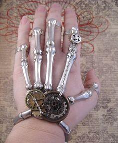 """Steampunk """"Clockwork Skeleton"""" Skeleton Hand Bracelet and Finger Rings - Explorer / Scientist / Assassin. $40.00, via Etsy."""
