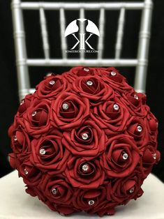 RED Flower Ball with BLING RHINESTONE GEMS. 12 Flower Ball is pictured with Rhinestone Gems.  RED Flower Ball made with PREMIUM Real Touch Roses. Add Bling Rhinestone Gems in roses or Pearl Brooches between the roses to add a little more bling to your special day! You will be amazed at how real and