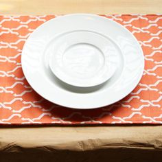 white plates and bold placemats