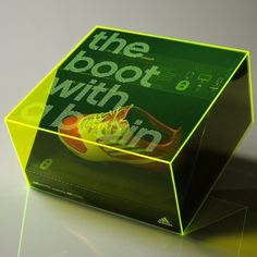 The boxes were litho printed, matt laminated, spot UV and foil blocked. They were supplied with foam inserts and hidden magnets which held the boot in place. A screen printed glow edge perspex lid then finished the pack off. These boxes were sent to Germany for the launch of the Adidas MiCoach football boots. The boots have a micro chip in the sole which collects movement data and stats from the wearer.