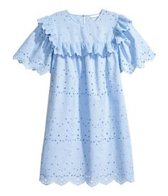 Light blue. Short-sleeved dress in woven cotton fabric with eyelet embroidery. Opening at back of neck with button, ruffled yoke at front and back