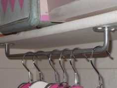hang towel rods upside down to use as unexpected hanging storage in the laundry room or a broom closet - so smart!