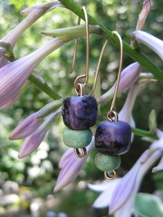 Charoite and Variscite hand made beads on gold and brass: http://manitoubeads.com/product-category/earrings/