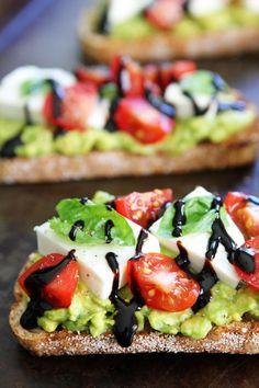 Caprese Avocado Toast Recipe on twopeasandtheirpod.com Caprese salad meets avocado toast! This is the BEST avocado toast!