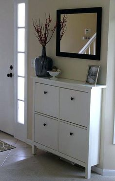HEMNES shoe cabinet from IKEA with mirror over it instead of a normal entryway table. takes up a lot less space! HEMNES shoe cabinet from IKEA with mirror over it instead of a normal entryway table. takes up a lot less space! Ikea Shoe Storage, Hallway Shoe Storage, Shoe Storage Cabinet, Garage Storage, Wall Storage, Ikea Hemnes Shoe Cabinet, Shoe Cupboard, Storage Mirror, Ikea Design