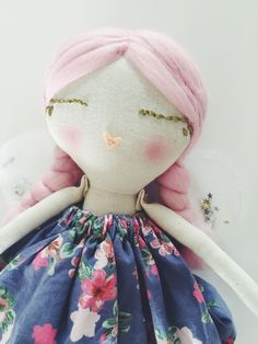 Pink haired fairy, wearing a floral gathered dress with silver sparkly socks and…