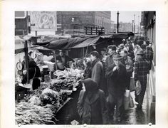 Even in winter, produce stands spilled across the sidewalks at the West Side Market, including these along Lorain Avenue.